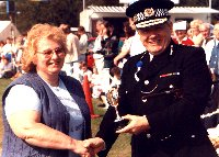 Jean West receiving cup for community service